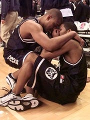 Butler's Mike Marshall (left) comforts teammate LaVall Jordan after the Bulldogs' last-second 69-68 overtime loss to Florida, March 17, 2000.