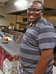 David Toluhi, owner of NairaLand West African Cuisine and Soul Food, and Beautiful Shades Restaurant & Event Center.