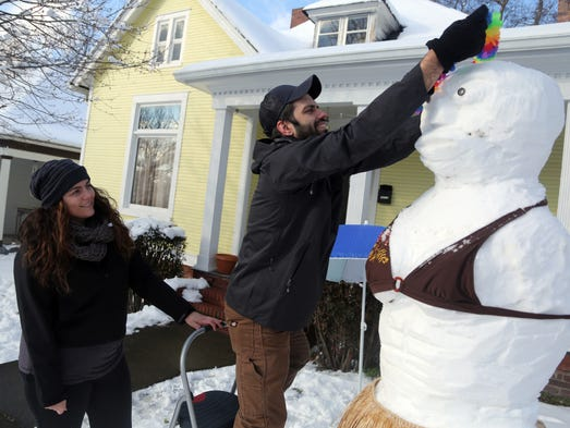 Rachael Wilkins and Derek Peck build an elaborate snowman