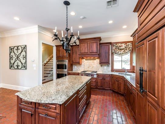 The kitchen features Brookhaven and Kitchen Craft Custom