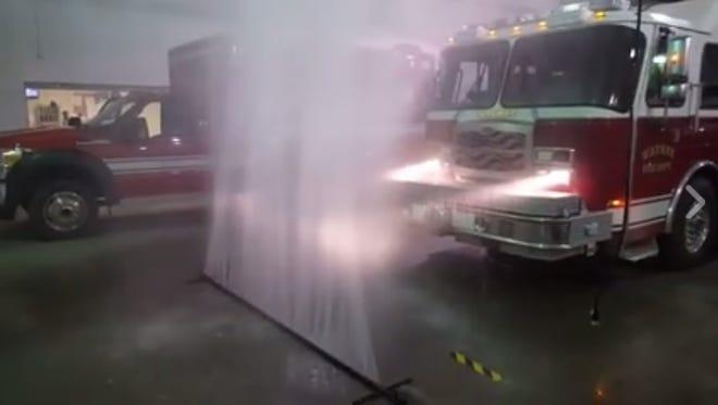 A Waukee fire truck drives through the department's homemade wash system.
