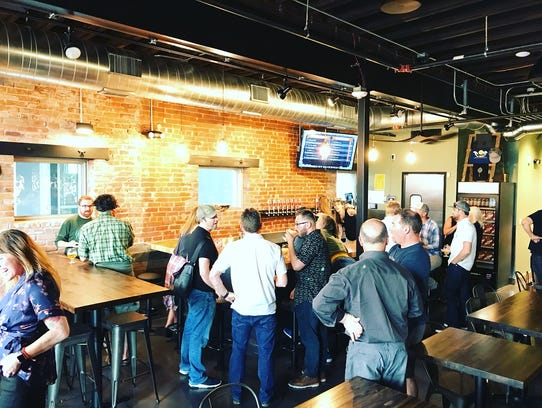 The first-level bar at the new Odell Brewing taproom