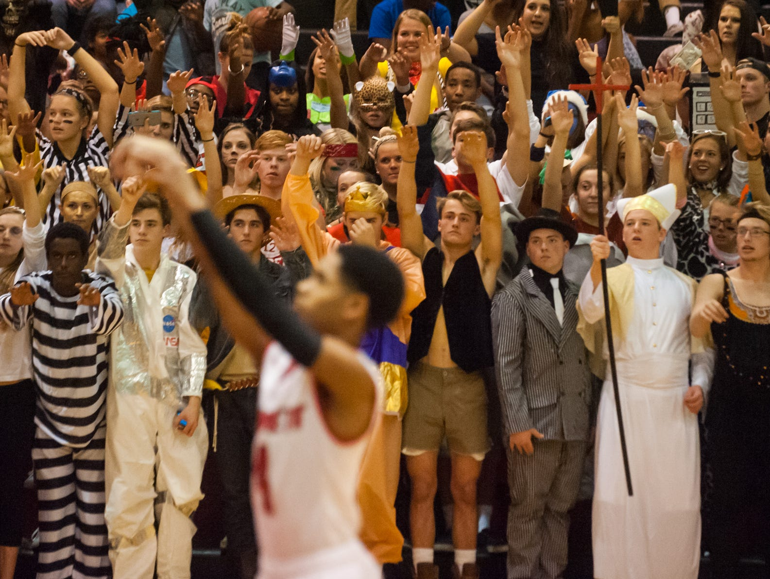 "FANS OF THE WEEK: The ""Bleacher Creatures"" at James M. Bennett were dressed to the nines and in full effect as the fan section showed their support last Friday against Snow Hill. The fan impact may have helped psyche out the Eagles in the Clippers' 77-44 win."