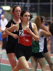 Briarcliff's Caroline Pennacchio breaks away from Ursuline's Sarah Flynn to win the girls 3,200-meter run at the Westchester County Indoor Track Championships at The Armory in New York on Jan. 30, 2016.