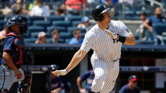 New York Yankees Mark Teixeira watches his solo, home run during the eighth inning of a baseball game against the Minnesota Twins in New York, Sunday, June 26, 2016. Minnesota Twins catcher Juan Centeno (37) is behind the plate.