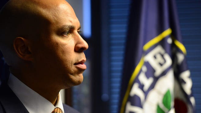 U.S. Sen. Cory Booker. U.S. Sen. Robert Menendez, and U.S. Sen. Cory Booker along with Newark Mayor Ras Baraka and Jersey City Mayor Steven Fulop and Jeanne LoCicero, ACLU, gathered in Booker's office to show their opposition to President Trump's executive order to ban people traveling to the United States from seven countries.  Tariq Zehawi/NorthJersey.com