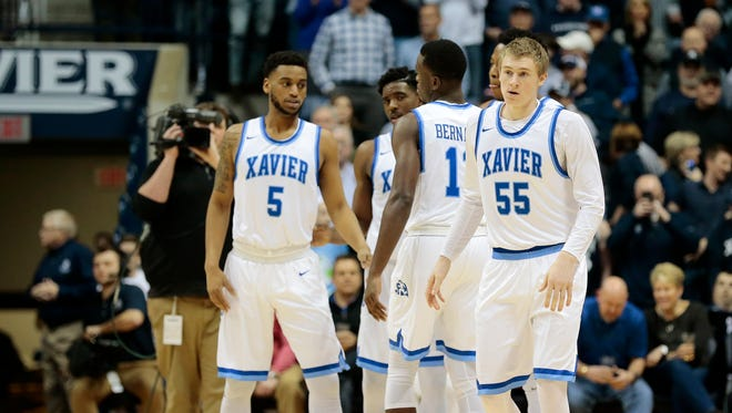 The Xavier Musketeers take the court wearing throwback uniforms.