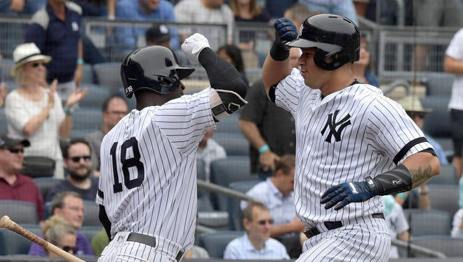 New York Yankees' Gary Sanchez, right, celebrates with' Didi Gregorius after Sanchez hit a home run during the third inning of a baseball game against the Minnesota Twins, Wednesday, Sept. 20, 2017, at Yankee Stadium in New York.