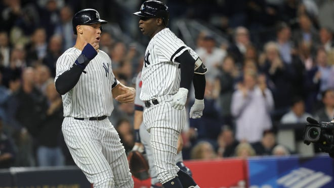 Aaron Judge and Didi Gregorius celebrate after Gregorius hit a three-run homer in the first inning to tie the AL wild card game against the Twins on Tuesday, Oct. 3, 2017.