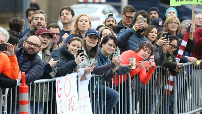 An estimated two million people lined the streets of New York City to watch the marathon, Sunday, November 5, 2017.