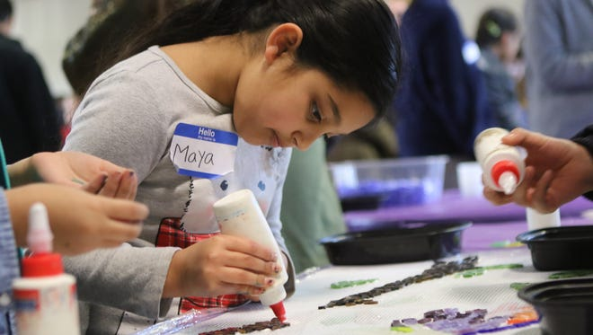 Maya Singh, 7, of Kearny, helps create art during an MLK Day event in Saddle Brook. Monday, January 15, 2018