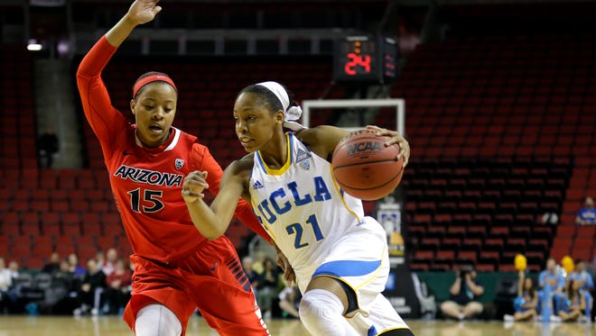 UCLA guard Nirra Fields, right, drives around Arizona guard Keyahndra Cannon, left, in the first half of a first round NCAA college basketball game in the Pac-12 women's basketball tournament, Thursday, March 5, 2015, in Seattle.