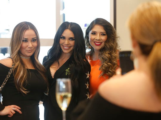 """Reality television star Scheana Shay, second from left, from the reality show """"Vanderpump Rules,"""" shares a moment with several of the invited guests at GAL Fashions. Shay was the special guest at GAL Fashion's second anniversary celebration Wednesday night. About 100 friends and customers of the local fashion store had an opportunity to meet the reality star."""