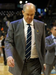 PIttsburgh coach Kevin Stallings walks off the court