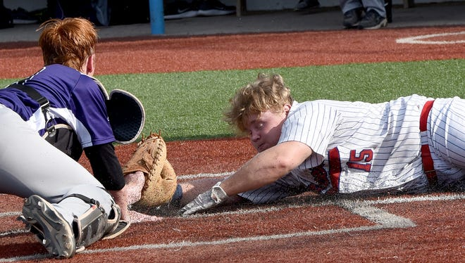 DeSales catcher Drew McLuckie tags out Lakewood's Branson Hinkle at the plate as Hinkle tries to tie it up for the Lancers in the fourth inning. Lakewood lost to DeSales 5-0 in a Division II district final on Thursday, May 18, 2017, at Beavers Field in Lancaster.