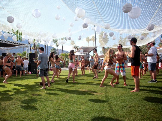 Attendees dance at the Hacienda Cantina & Beach Club during the Splash House party in June 2015. The lawn area shown in the photo is where developers propose to build a 66-room hotel addition to the restaurant property.
