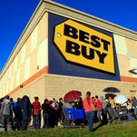 In this Nov. 27, 2014 file photo, customers stand in line as they wait for the doors to open  at Best Buy in McAllen, Texas.
