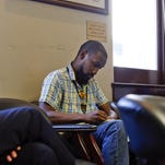 Phillip Bailey on assignment at the Democratic Caucus meeting at City Hall on July 24.