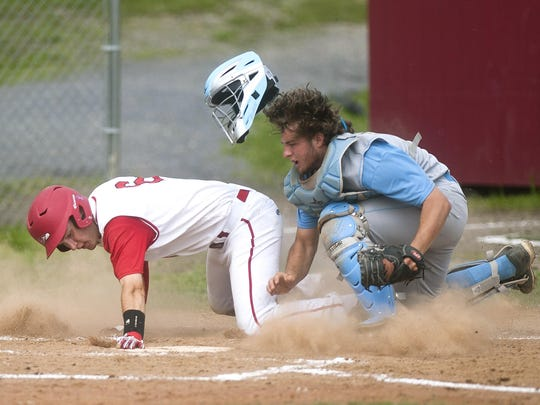 South Burlington catcher Henry Cunningham, right, blocks the plate to tag out Champlain Valley's Will Potter during the first inning of Wednesday's Division I semifinal.