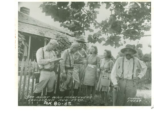 Local citizens converse with troops during the Louisiana maneuvers in August 1940.