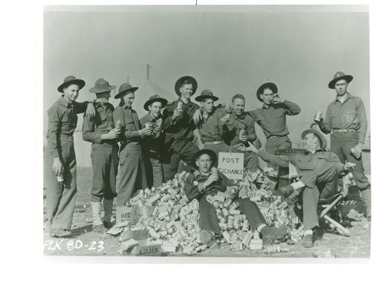 Soldiers relax with a great quantity of Blatz beer during downtime in the Louisiana Maneuvers in 1940.
