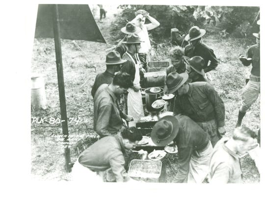 Soldiers enjoy a hot meal from a field kitchen during the Louisiana Maneuvers. Feeding large numbers of soldiers in the field was another critical logistical task learned during the maneuvers.