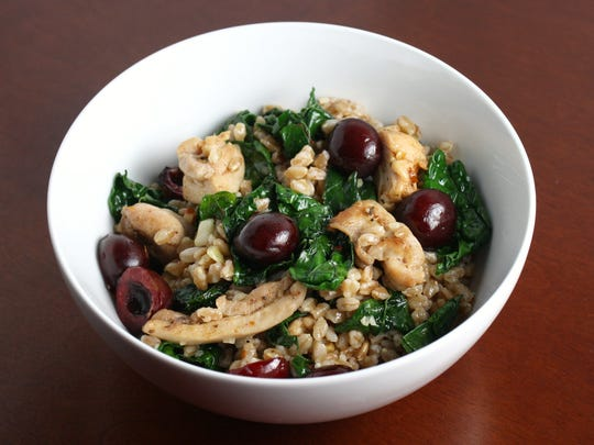 Spicy Farro Salad with Kale, Chicken and Cherries is hearty enough for a main dish and packs well for a picnic.