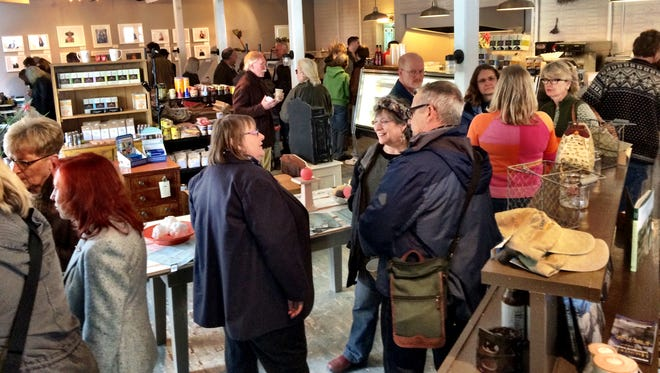 Friends, family and strangers gather at Clinton Cheese & Provisions Sunday to support the Sheehan and Cihanek families, both of Red Hook, who lost a barn and 100 goats to a fire in February.