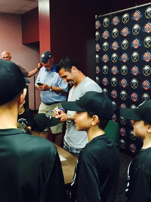 Sabres captain Brian Gionta signs autographs for squirt players at summer camp at Bill Gray's IcePlex on July 24, 2015.