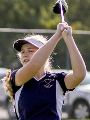 Knoxville High School junior Kaci Luptak watches her drive from the first tee during the Blue Bullets' match with Mid-County, Princeville and Farmington at Bunker Links on Thursday, Sept. 24.