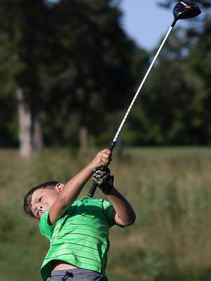 Benton Davis, 8, hits a drive from the 17th tee as he competes in the boys 8-9 division of the Galesburg Junior All-City golf tournament on Tuesday, at Bunker Links.