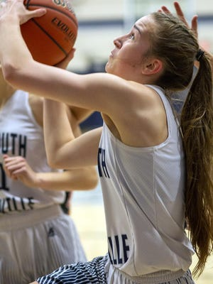 Monmouth-Roseville's Lily Cundiff puts up a shot in a home affair against Macomb on Monday, Jan. 6.
