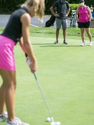 Galesburg High School head girls golf coach Brad Gross, left, and first-year assistant Jessica Allgood keep an eye on the putting green at Lake Bracken during the first day of practice for the Silver Streaks on Tuesday.
