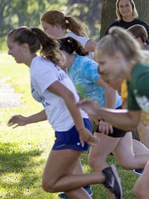 Galesburg High School girls cross country coach Jody Chapman watches her runners during practice on Tuesday morning, at Lake Storey.