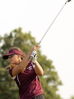 Williamsfield sophomore Madie Gonzalez hits a drive from the second tee during the Bombers' four-way match with Mid-County, Princeville and Mercer County on Monday at Oak Run in Dahinda.