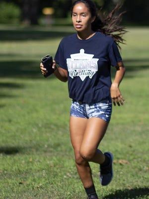 Monmouth-Roseville high school junior Dayanna Moraortiz runs through Monmouth Park during the Titans' cross country practice on Wednesday, Aug. 19.