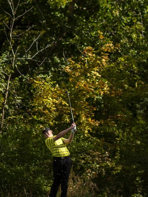 Galesburg High School's Jason Runbom watches a shot in regional play Tuesday at Gibson Woods, in Monmouth.