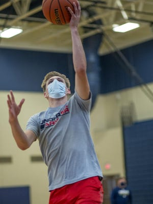 Knoxville High School senior Jason Hise shoots a layup during a workout drill on Friday, Sept. 25.