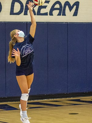 """Monmouth-Roseville junior Belle Thompson hits a serve during volleyball contact day on Tuesday in """"The Shoebox."""""""