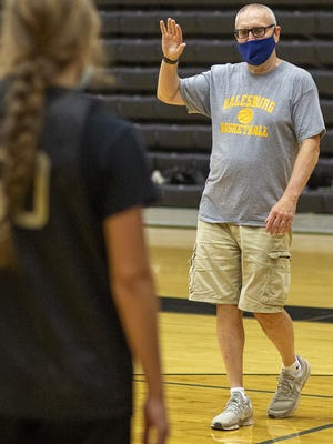 Galesburg High School girls basketball coach Evan Massey goes through a drill with the Silver Streaks during a workout on Tuesday, Sept. 15,  at John Thiel Gymnasium.