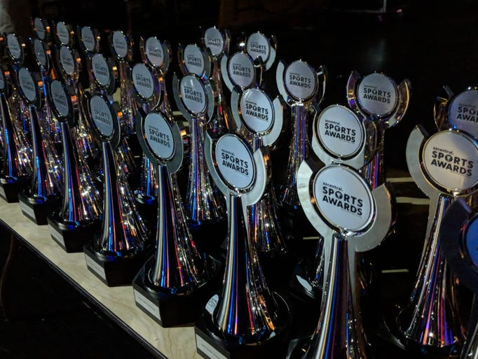 Trophies are lined up back stage at ASU Gammage for