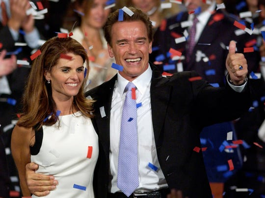 Arnold Schwarzenegger and Maria Shriver celebrate his victory in the California gubernatorial recall election in Los Angeles on Oct. 7, 2003.