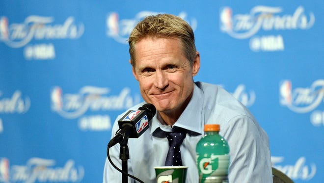 Steve Kerr talks to media during a press conference after Game 3 of the NBA Finals against the Cleveland Cavaliers at Quicken Loans Arena.
