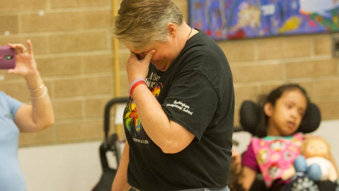 Dori Dunham reacts to being surprised with the ESE Teacher of the Year award on Friday, April 15, 2016, at the Buckingham Exceptional Student Center.
