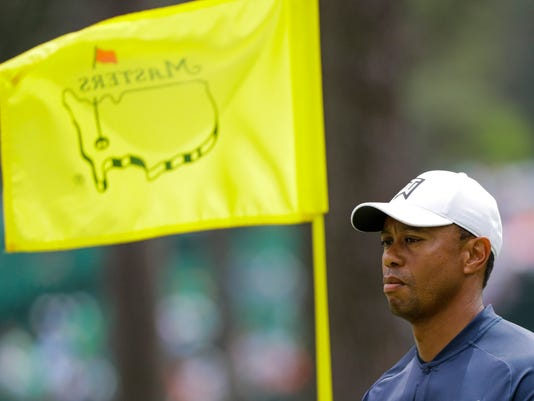 Tiger Woods walks on the sixth green during a practice round for the Masters golf tournament Wednesday, April 4, 2018, in Augusta, Ga. (AP Photo/David J. Phillip)
