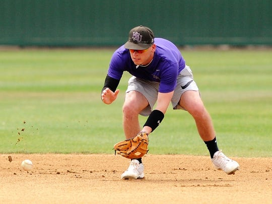 Hardin-Simmons senior shortstop Taylor Cooling goes to field a grounder during the Cowboys' practice on Wednesday, May 2, 2018. Earlier this season Cooling broke the HSU school record for doubles in a career and now has 56 entering the American Southwest Conference tournament on Friday in Alpine.