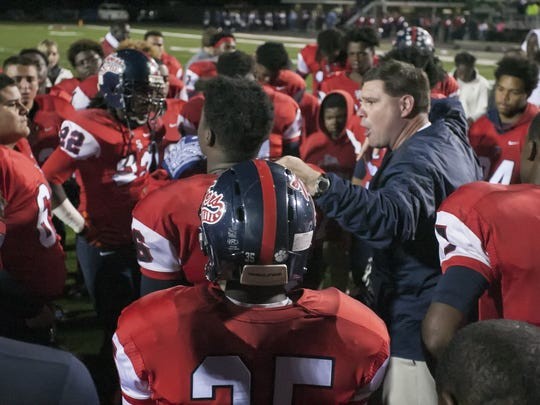 Lance Pogue speaks to his team on the field for the final time following South Panola's loss to Warren Central in the first round of Class 6A playoffs.