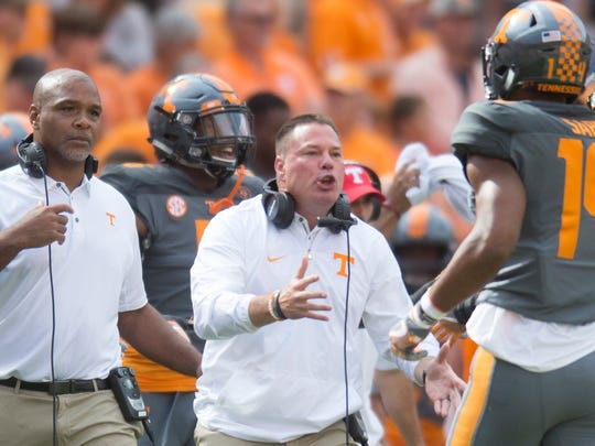 Tennessee Head Coach Butch Jones calls to players during the Tennessee Volunteers vs. Georgia Bulldogs game at Neyland Stadium in Knoxville, Tennessee on Saturday, September 30, 2017.