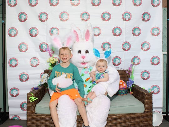 Adam and Lilly Lovell pose for a photo with the Easter