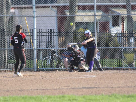 Cudahy's Tori Gorski connects with a pitch during a
